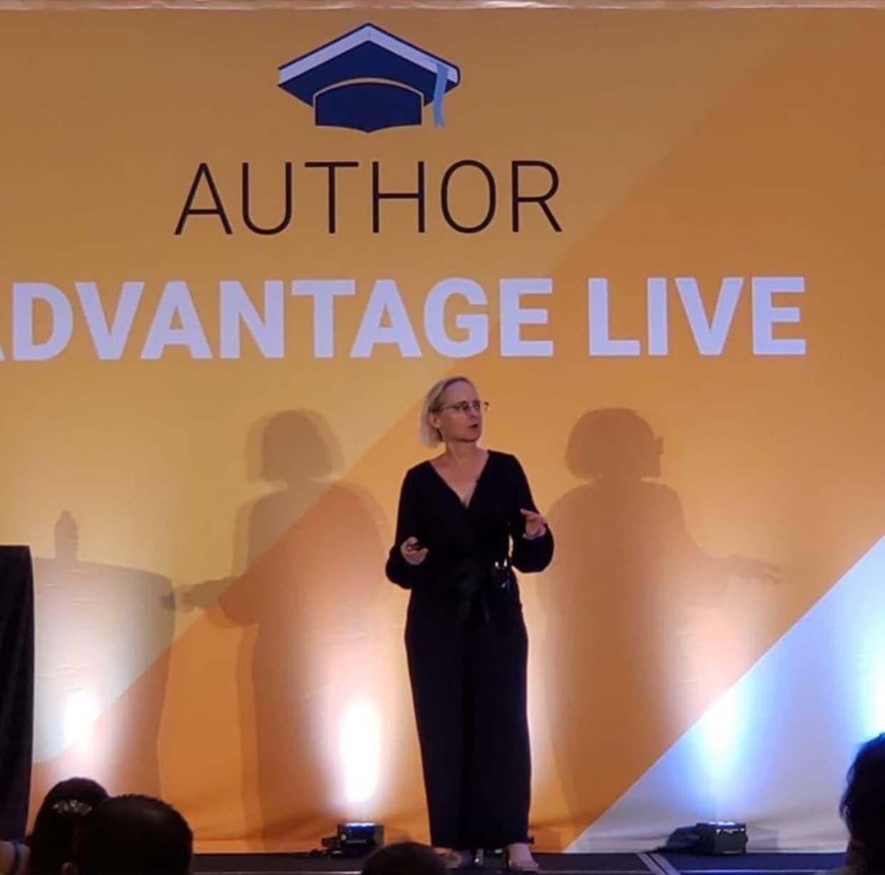 Nancy Hillis preparing to speak on stage at Author Advantage LIVE